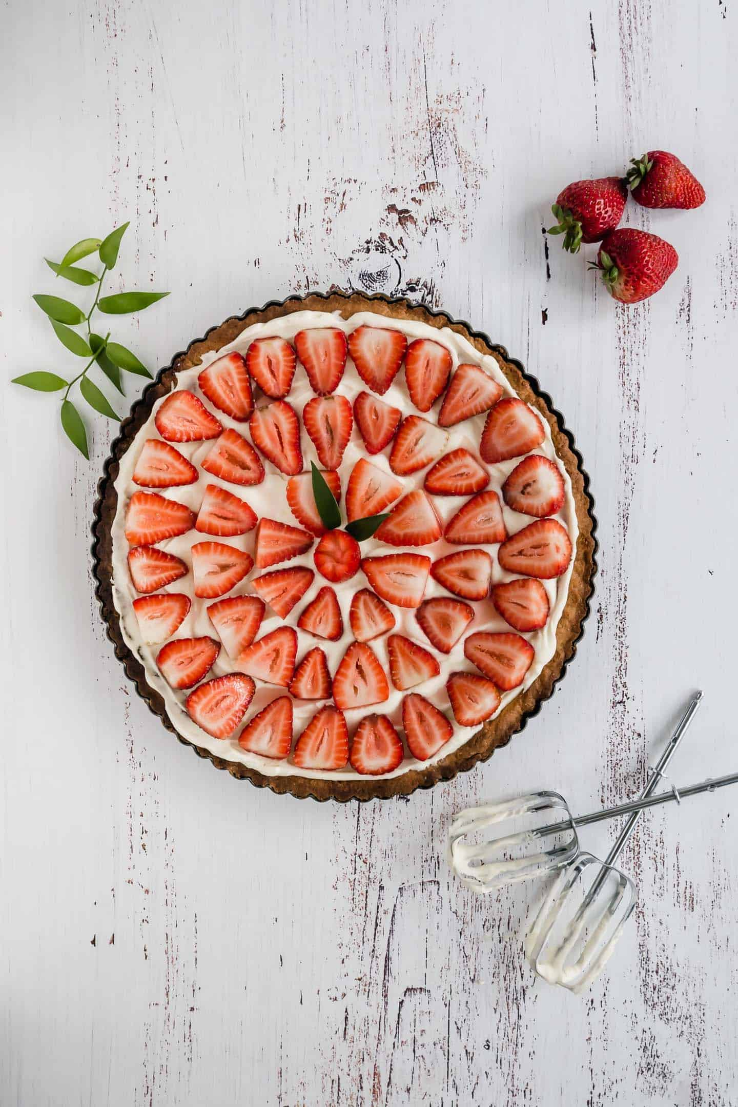 Traditional Strawberry and Cream Tart. Simple as a buttery shortbread crust, smooth creamy filling and a fresh strawberry topping.