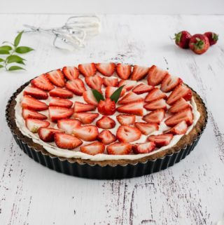 Traditional Strawberry and Cream Tart. Simple as buttery shortbread crust, smooth creamy filling and fresh strawberry topping.