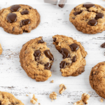 Close shot of the Walnuts and Choc Chunks Cookies on a white background A cookie cut in half