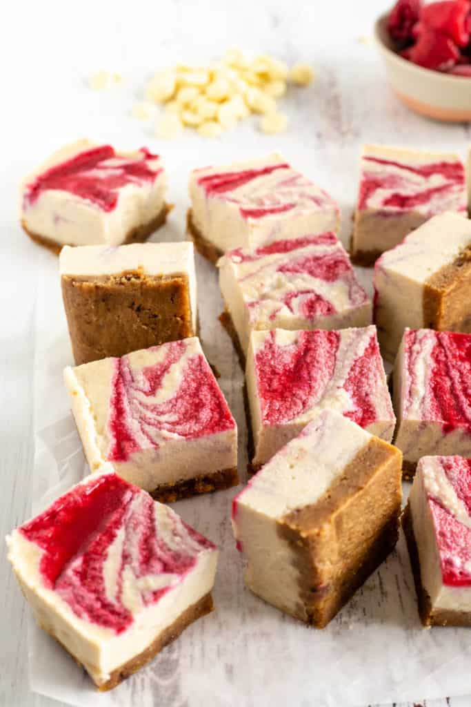 Raspberry and white chocolate bars on a white surface